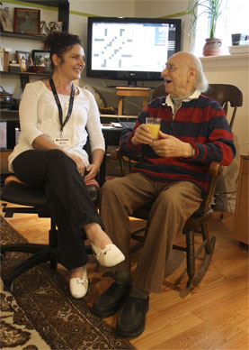 Senior and Caregiver in discussion