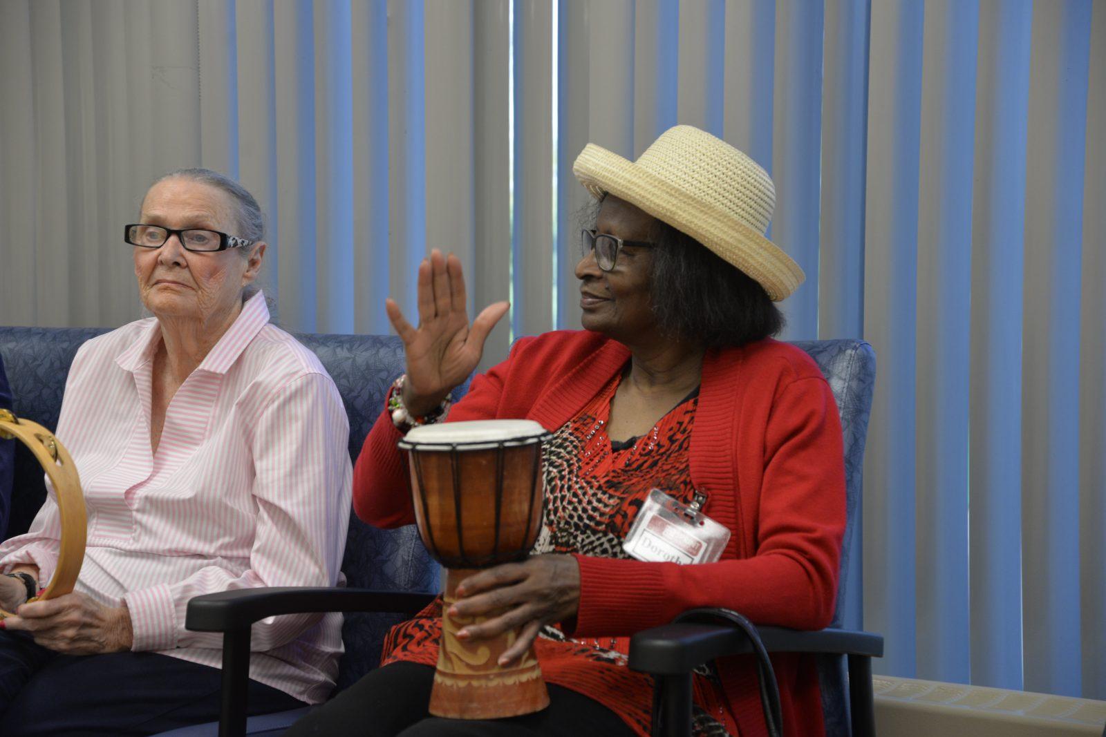 senior lady playing drum