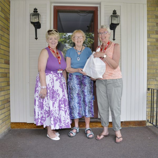 Ladies on Porch with gift package