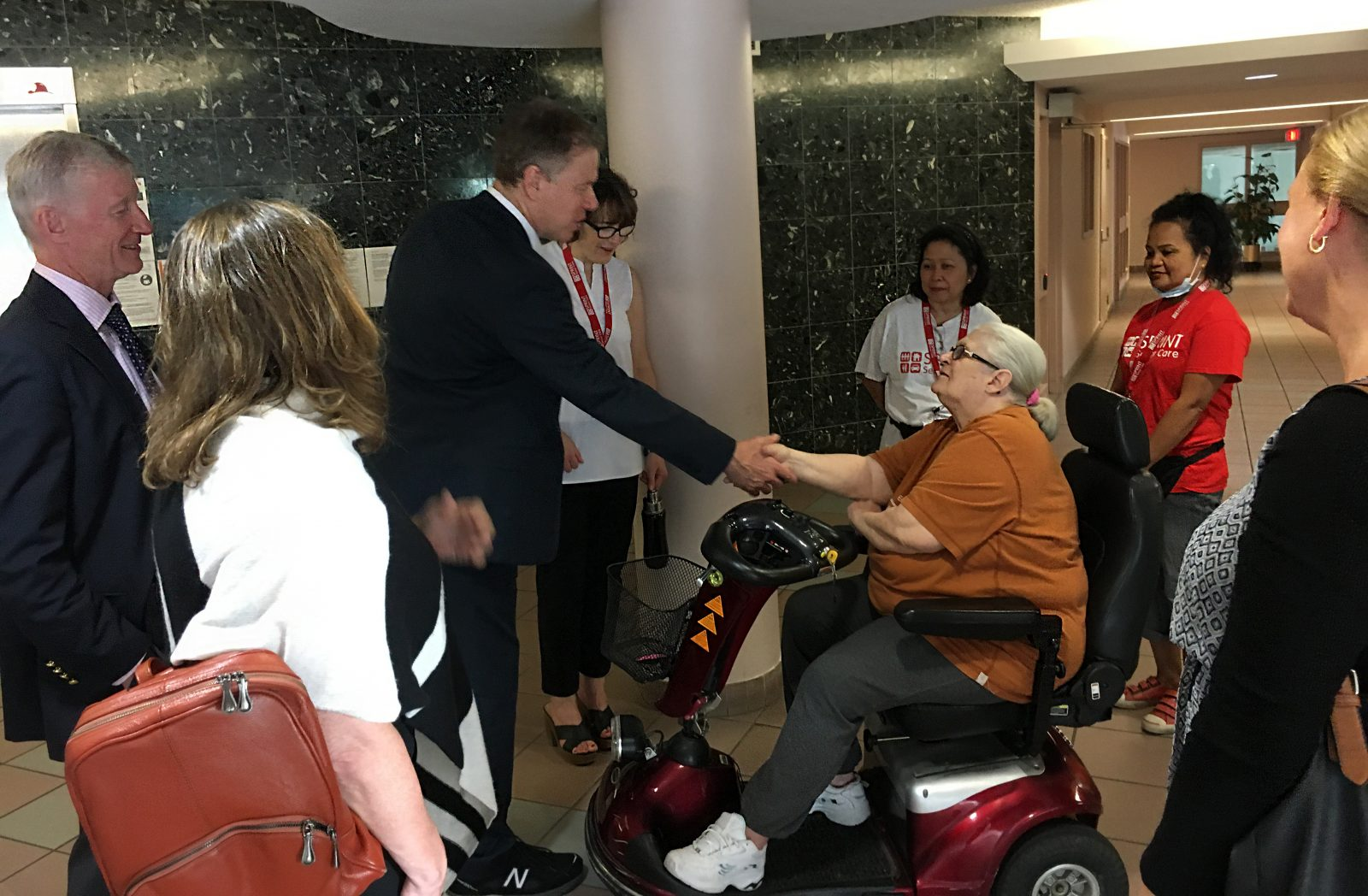 Sunnybrook CEO shaking hands with senior