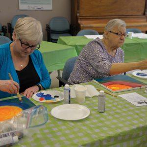 2 ladies painting at table, SPRINT Senior Care