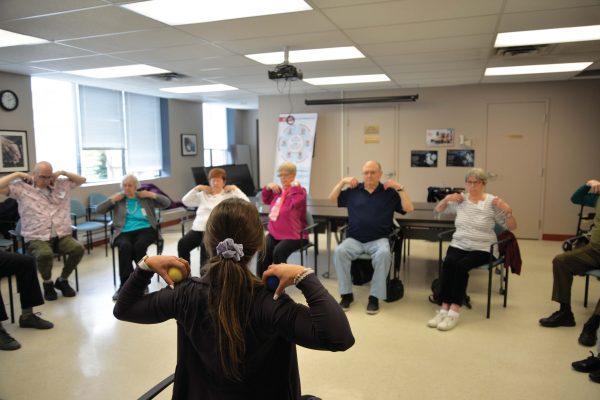 Seniors in Seated Yoga class
